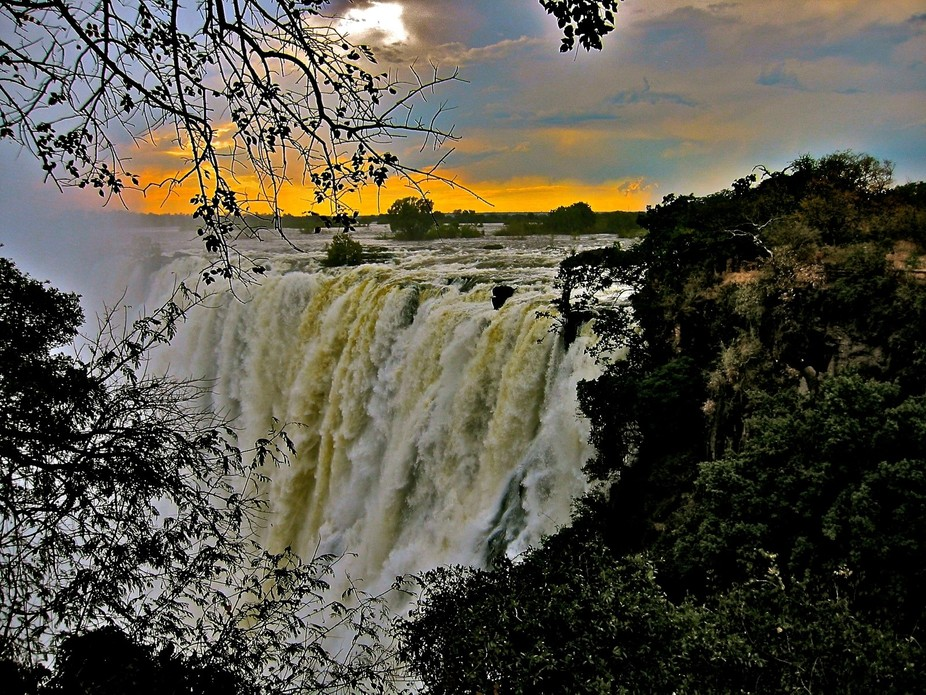 SUNSET WONDER....ONE OF SEVEN WONDERS OF THE WORLD....VICTORIA FALLS...THE SMOKE THAT THUNDERS......
