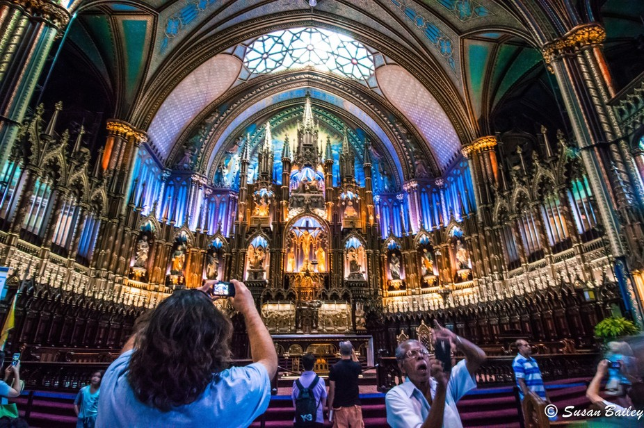 The Basilica of Notre Dame in Montreal is an astounding site- hence what the older man is doing i...