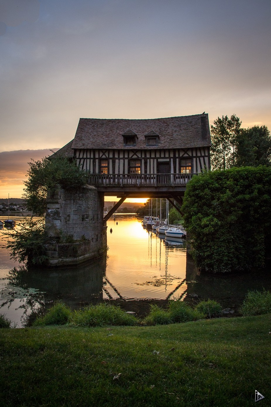 sunset behind the house over the river by amazed - Around the World Photo Contest By Discovery