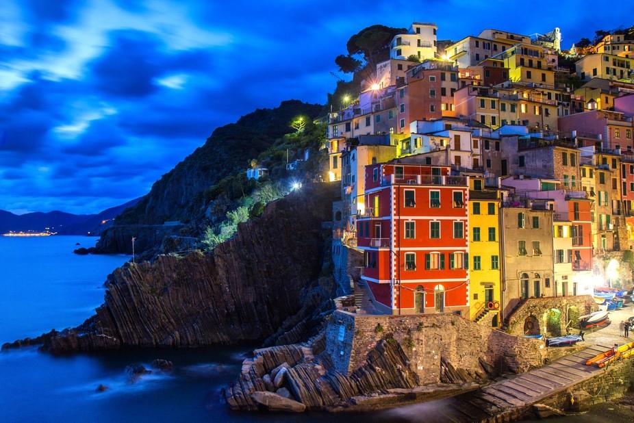 Wonderful village of Riomaggiore, in Italian UNESCO site Cinque Terre, photo taken during blue ho...