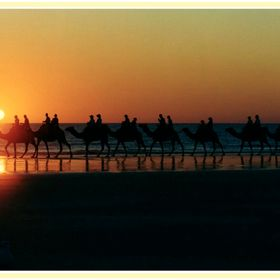 Tourists enjoy a twilight ride on Broomes iconic Cable Beach as the sun sets over the Indian Ocean.