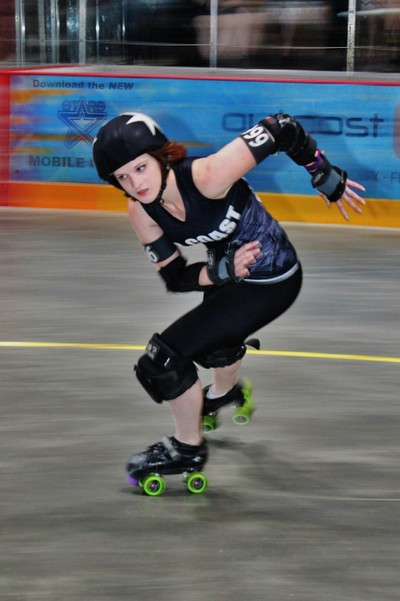 Sunshine, No Coast Derby Girls August 20 Bout Poster Girl.  The Photos is by me.