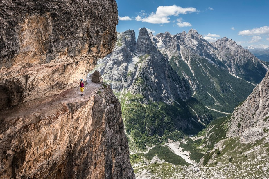 Traversing the wild ledges of Strada deli Alpini in the Sexten Dolomites.