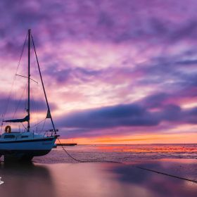 The boat Xanet at Dawn and low tide, taken at Shoebury Sands Southend, Essex.