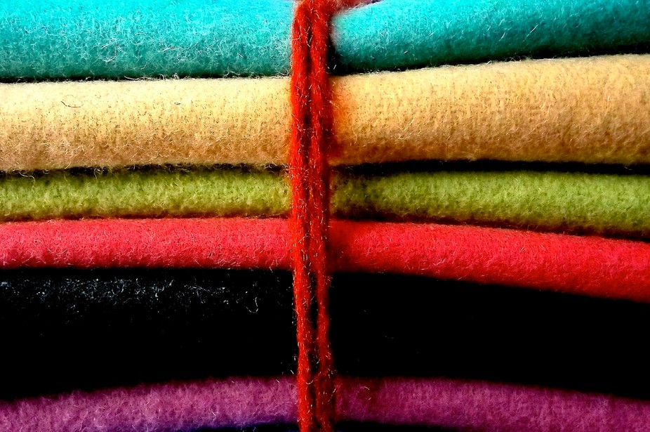 a colorful stack of hand-made felt