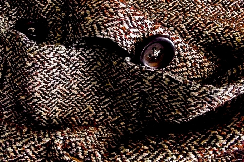 tweed and wooden button