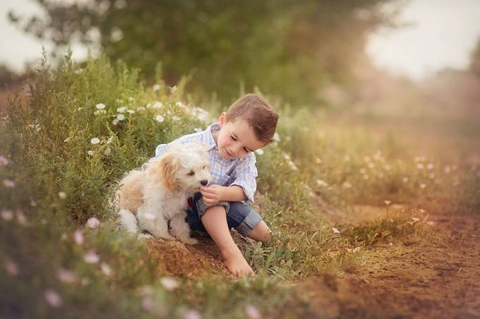 Feeding his puppy flowers!! by Lindsey_Shedd - Kids With Props Photo Contest