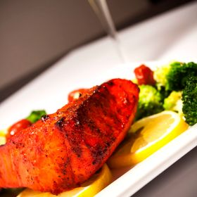 Broiled salmon with sautéed broccoli