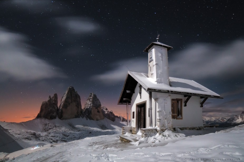 While i was taking photos of the Three Peaks, in Dolomities, I noticed this little church behind ...