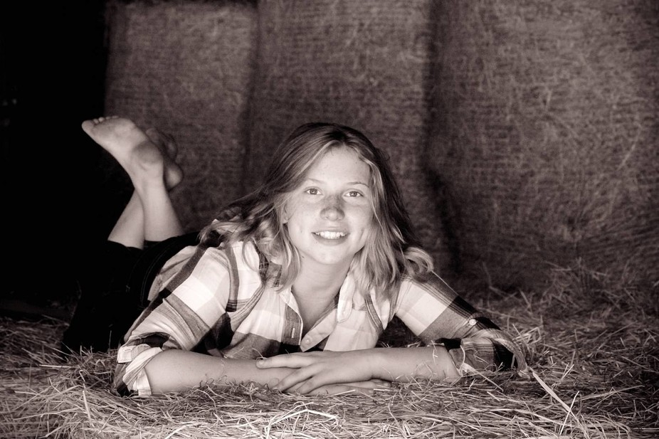 We were at a local farm scoping it out for a photo shoot and my daughter hopped up on the hay and...
