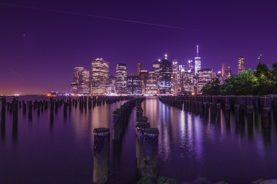 Remnants of the old pier at Brooklyn, looking over to the lower Manhattan just after sunset