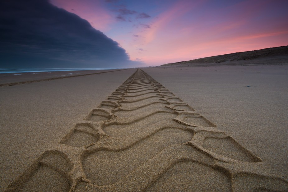 Tractor trail at the beach of Katwijk, a small coastal village in Holland.