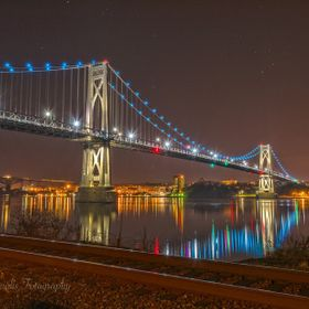 The lights to this beautiful bridge change nightly. In this capture, the bridge is adorned with Hanukah Blue! The Mid Hudson Bridge connects the ...