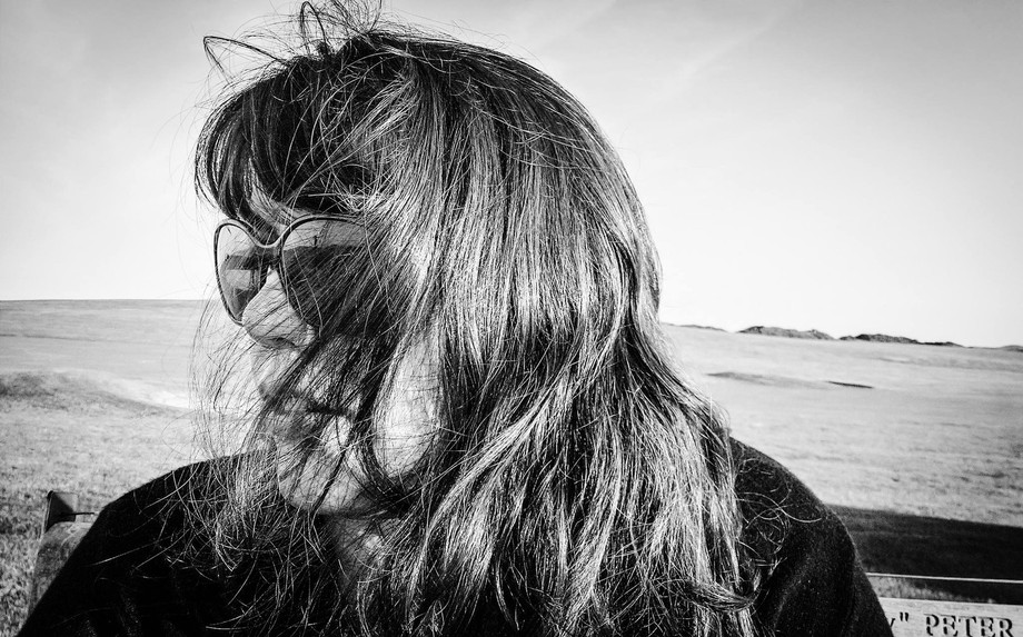 Taken by the cliff edge in a Wales on a windy day, I loved the fact the wind was making her hair ...