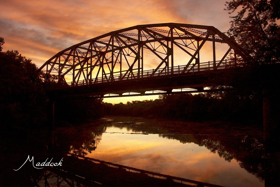 Silhouette Caney River bridge, Bartlesville, Oklahoma at sunrise