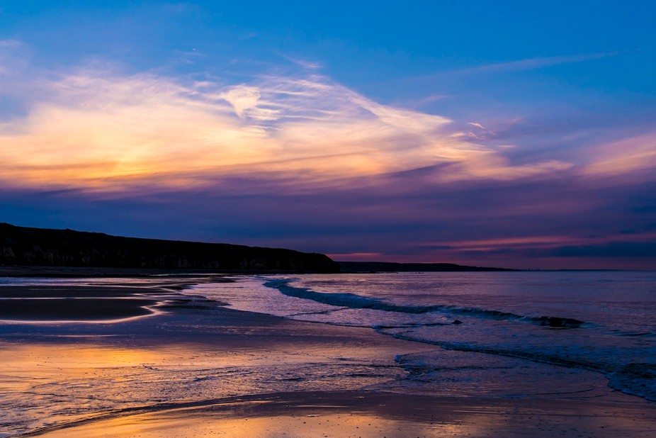 A sea view at Crimdon Northeast England after the sun has set.