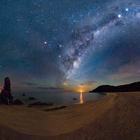 Under the watchful gaze of Navigator Rock, an interplay of curves surround a rising crescent moon... The golden sands of Abel Tasman National Par...