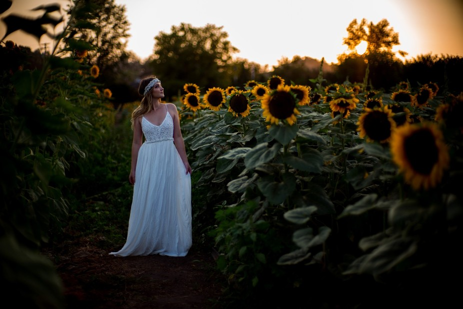 The sunset was captured as we ran through sunflower fields to create this memory!