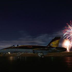 A night exposure of a F18 Hornet with fireworks taken at a local airshow.