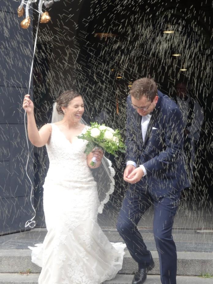 American wedding in Berlin.  Raining rice!