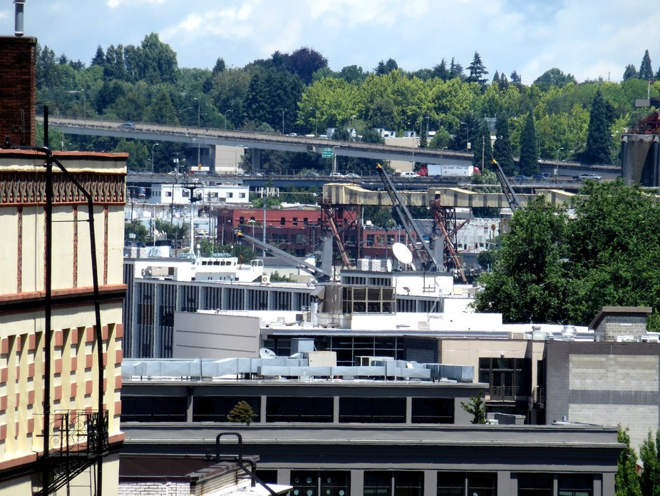 From the top of a 6 story garage, looking east across the river. Grain elevators and freeways and...