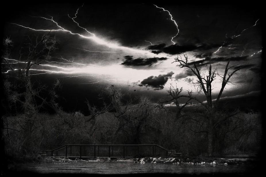Dark skies over a bridge