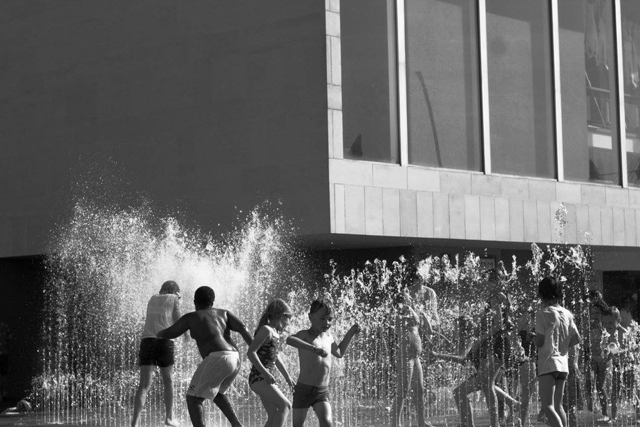 Children playing in a fountain in London.