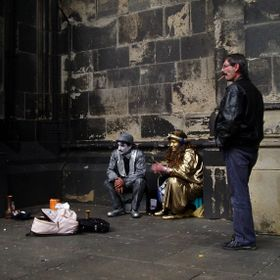Spotted in a recess at the side of Cologne Cathedral two mimes take a lunch break. On seeing me they started to pose and the natural informality ...