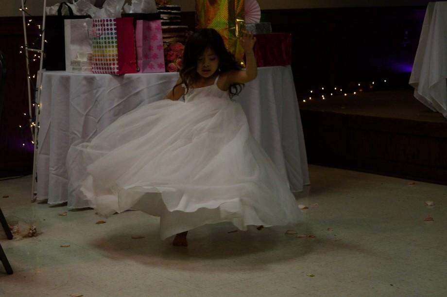 Little girl enjoying the music and her fancy dress