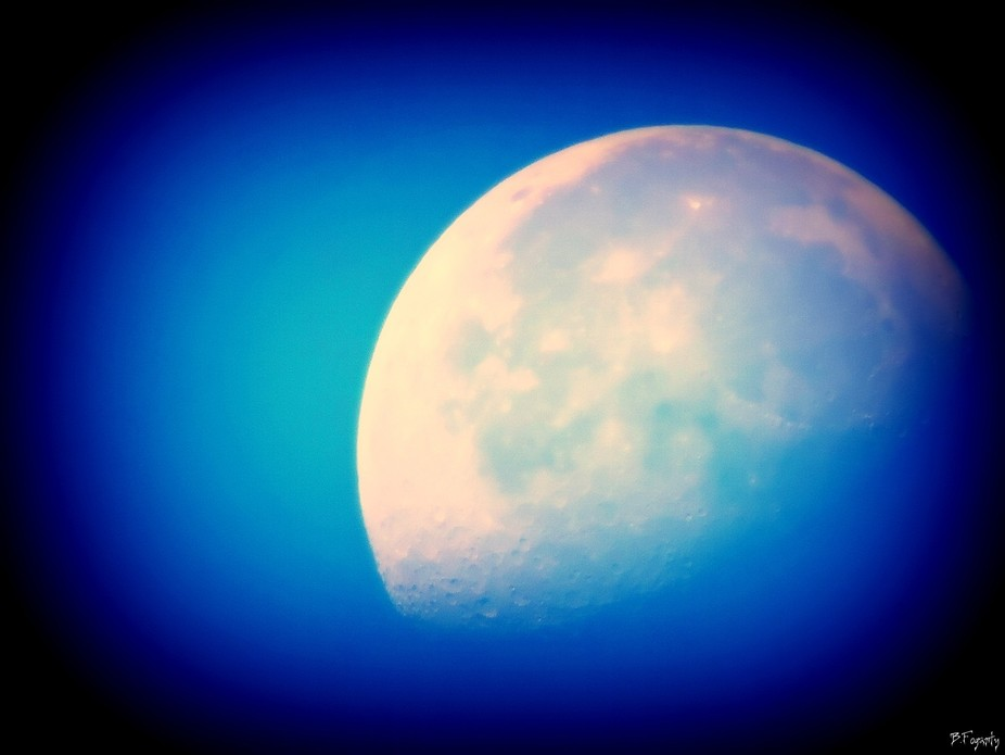If a moon actually looks Blue it is cause by rare types of dust in the atmosphere.This can happen for Instance after a dust storm,Forest fire or an volcanic eruption .