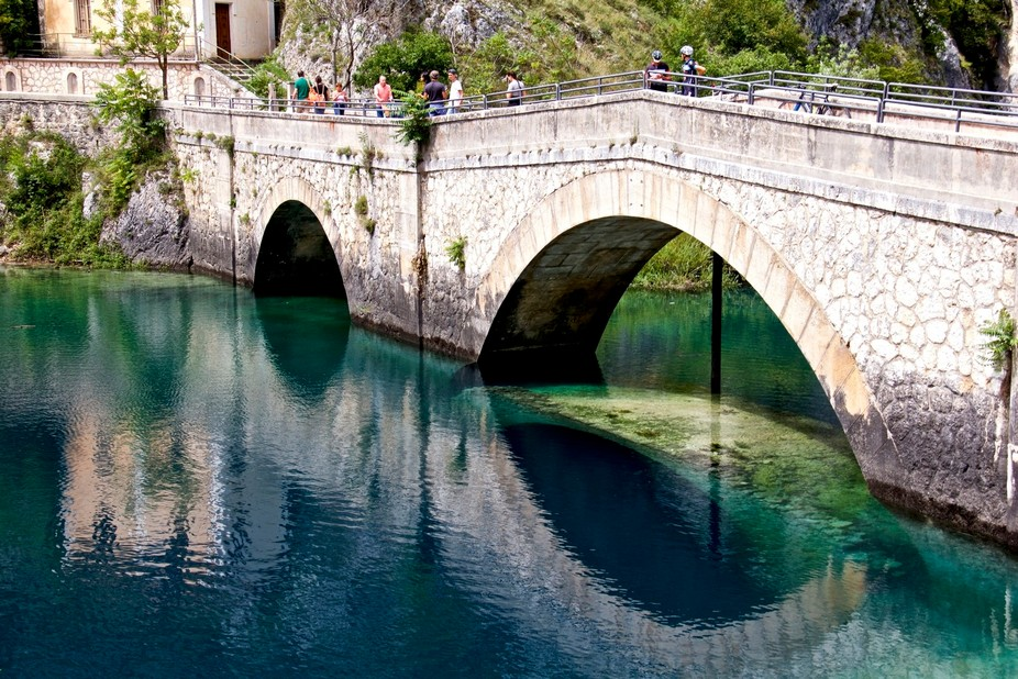 Beautiful lake in Villalago Italy. The color of the water is like nothing I've seen outs...