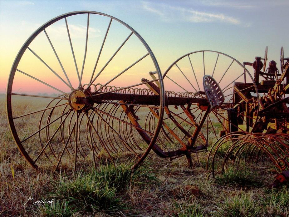 Old horse drawn rake at sunset in Oklahoma