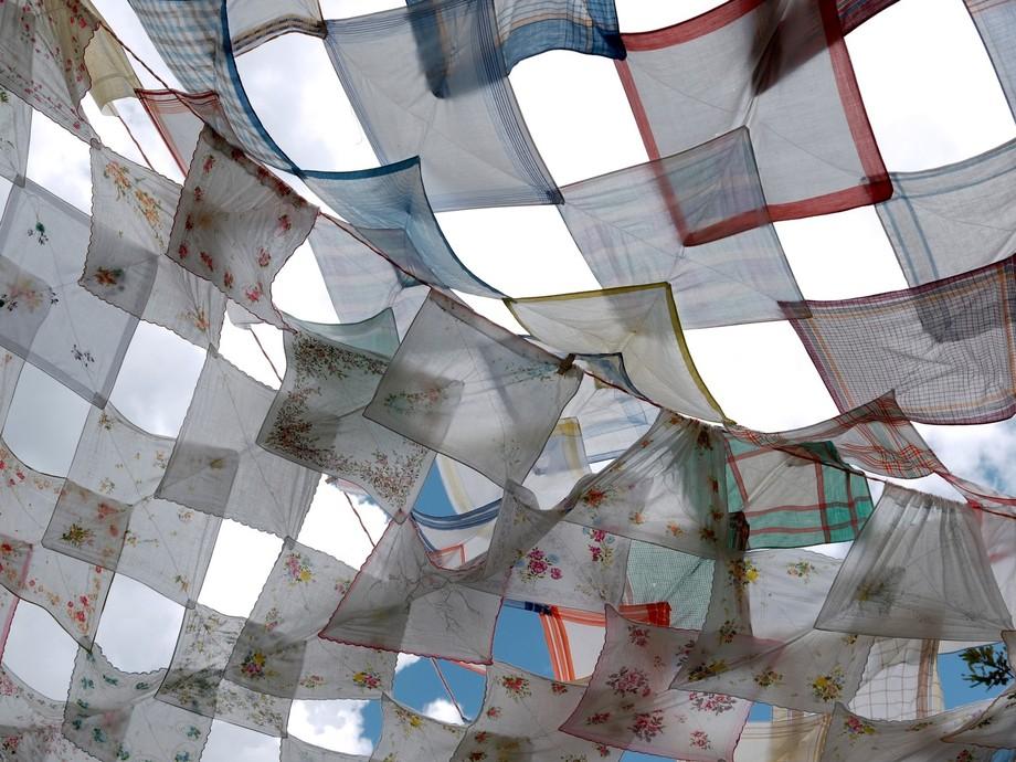 Knotted handkerchiefs filtering direct sunlight