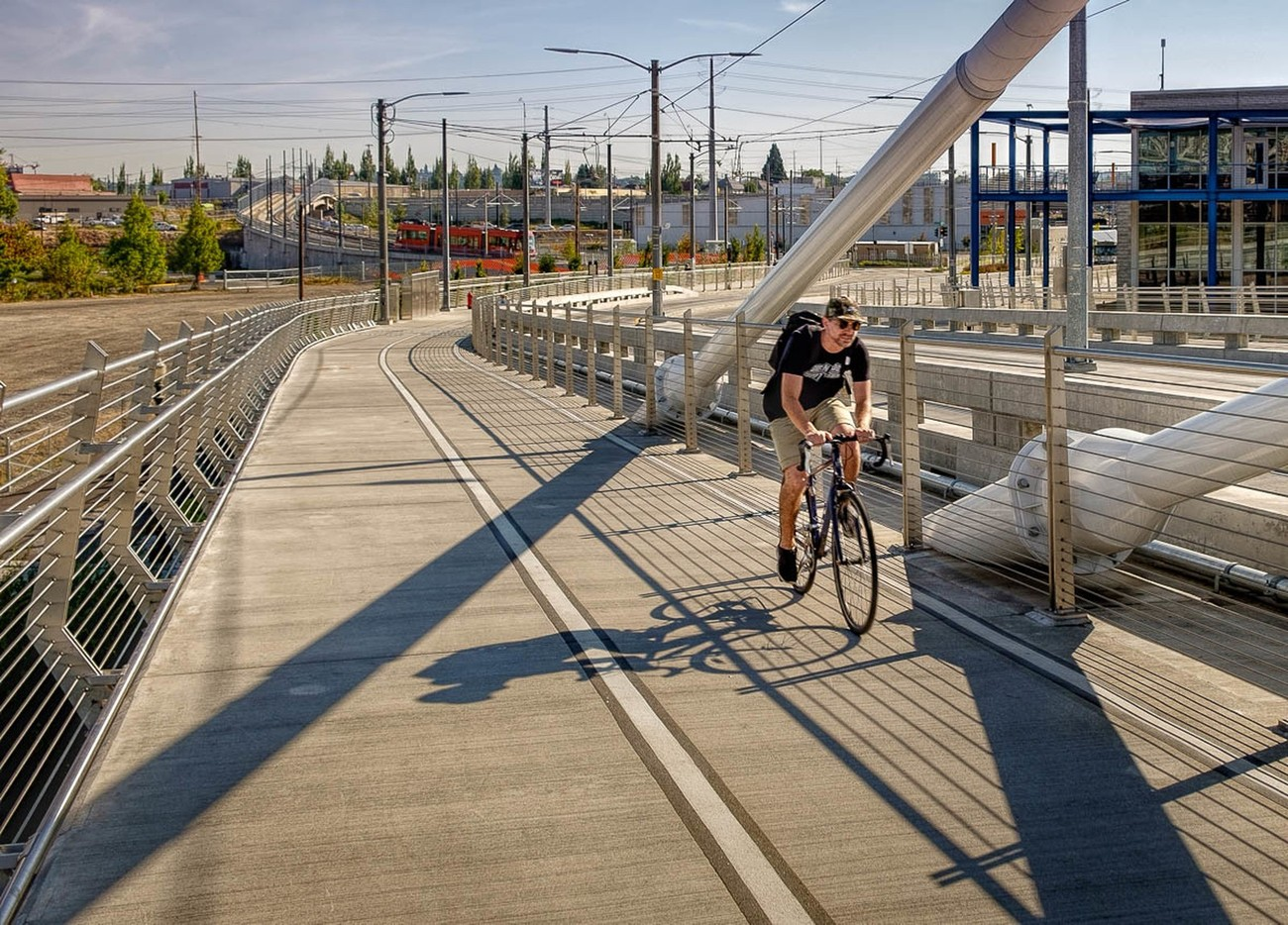 I went out today to capture the new pedestrian and rapid transit bridge in Portland called Tilikum Crossing. While there it was only fitting to photograph a cyclist as he crossed the river from east to west.