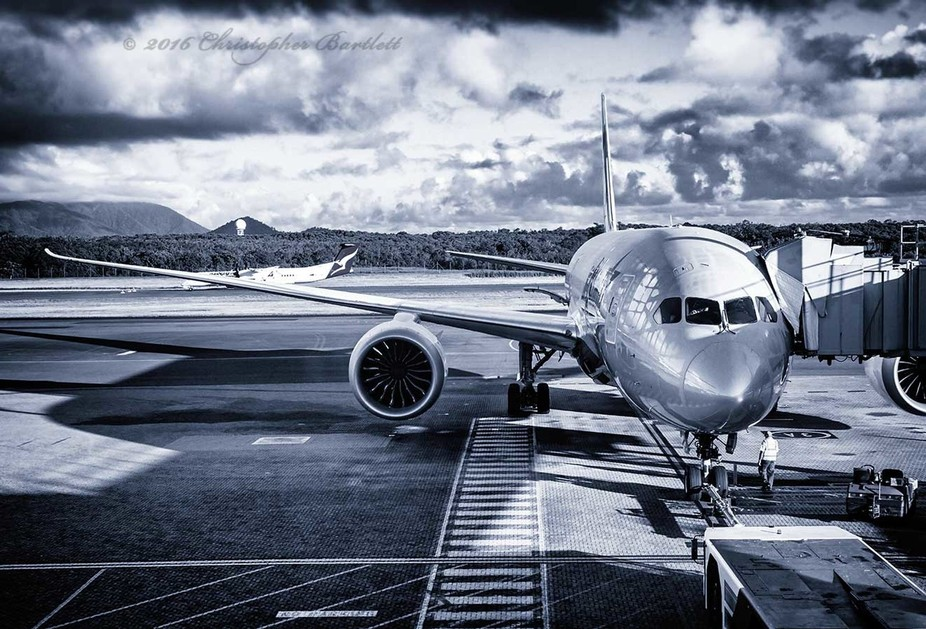 This image captures the way Cairns Airport is surrounded & contained by mountains and rai...