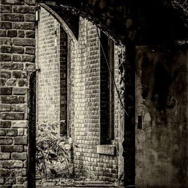 """This arched passageway is part of the Babcock Building.  Built in the period between 1857-1885 the Babcock Building was to become the """"new asylum"""" for the South Carolina Lunatic Asylum which would later be known as the South Carolina State Hospital."""