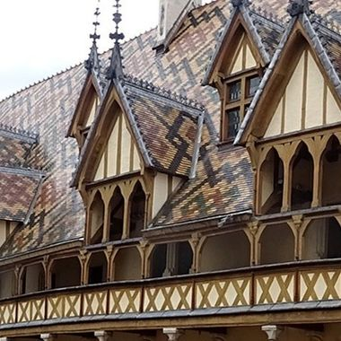 The Hotel Dieu De Beaune or the Hospices de Beaune is a former almshouse in Beaune, France.  It was founded in 1443 by the chancellor of Burgundy, Nicholas Rolin as a hospice for the poor. The magnificent tiled roof of the building is something to see.