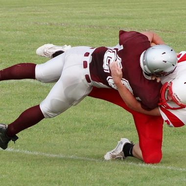 This is my nephew, who is a senior in high school, tackling an opponent at their first game of the season.