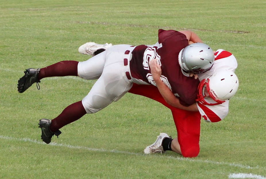 This is my nephew, who is a senior in high school, tackling an opponent at their first game of th...