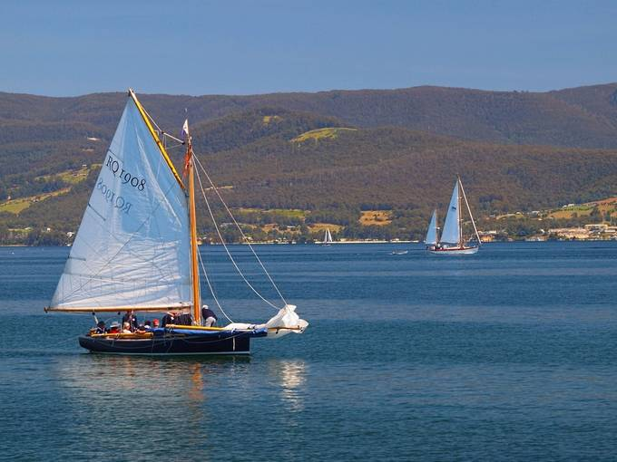 Lazy summer afternoon and the yachts cruise the bay. Tasmania, Bruny Island.
