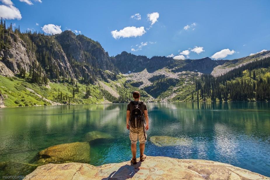 Lone hiker at Spar Lake, Kootenai National Forest, Montana.