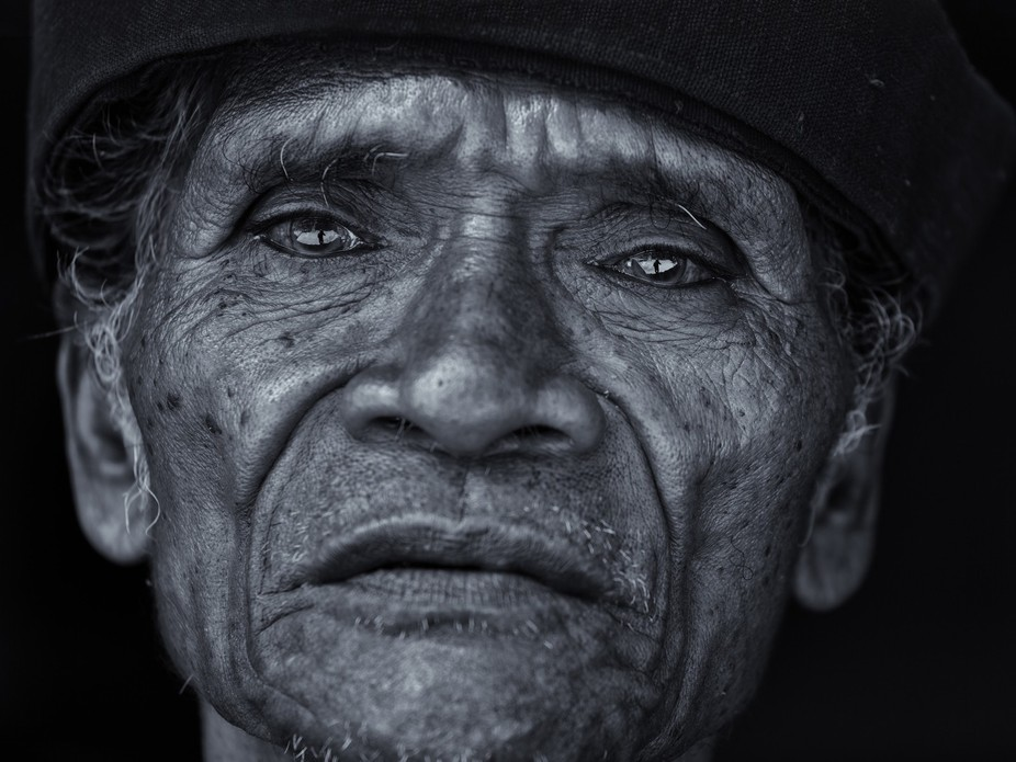Candid portrait of an old man in a Ngada village on Flores, Indonesia.