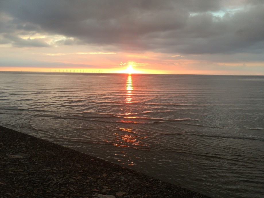 Taken in Liverpool Merseyside a beautiful sun over the sea once the tide had come in