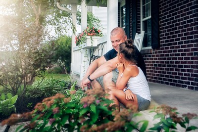 father and daughter on front porch