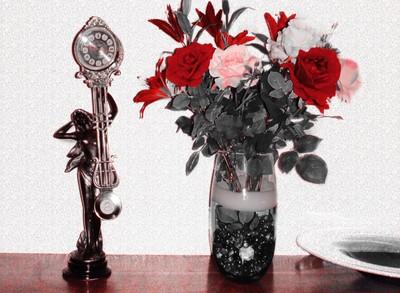 reloj y flores