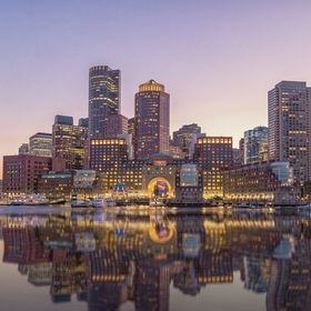 A view of downtown Boston from the harbor during the blue hour.