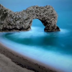 Long exposure showing the moving waters in and around the Durdle Door arch. Jurrasic Coast, Dorset, UK.