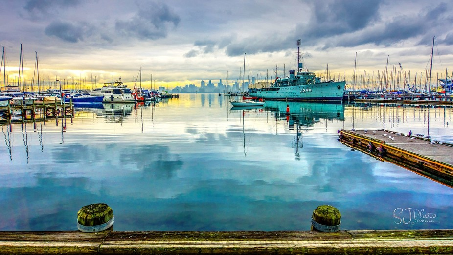 A view from the docks at Williamstown across Hobsons Bay to the Melbourne skyline with boats from...