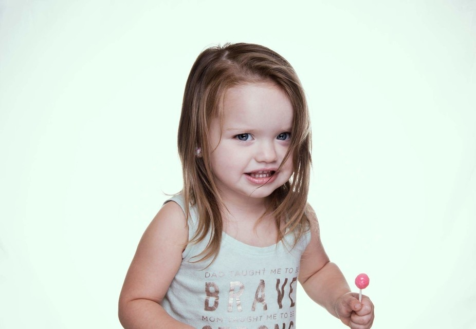 My wife and I just got our lighting kit and our 2yr old daughter was acting as our model. We had ...