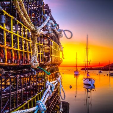 Sunrise with Lobster traps & sail boat